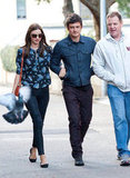 Miranda Kerr held onto Orlando Bloom in Sydney.