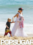 Gwen Stefani Shows Hints of a Red Bikini at the Beach
