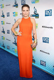 Sophia Bush certainly has a thing for the color orange, and you know what? It totally works. This time, the actress wore the electric hue in a halter-style Olcay Gulsen column-silhouette dress, accenting the look with chunky gold jewelry and a Judith Leiber clutch.