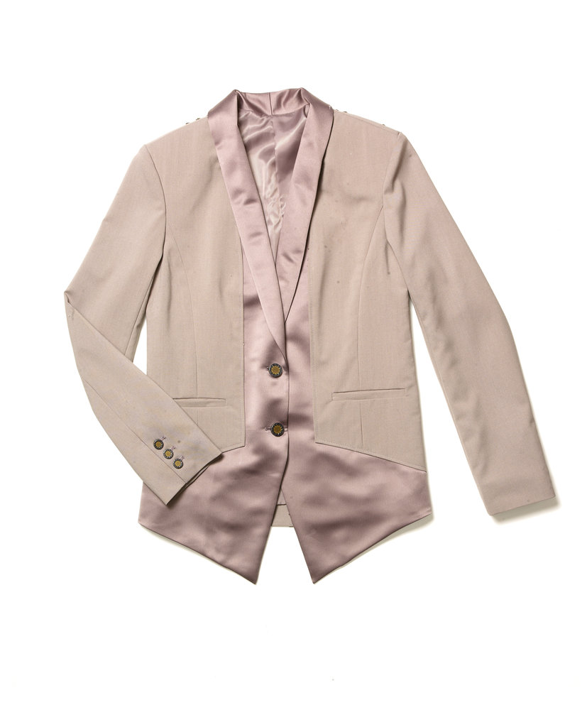 I really love this blazer with the embellished shoulder. You'll notice it's all about the little things — the buttons, the zipper pulls. This [point to the buttons] is a design that I've actually pulled from a House of Harlow piece, the Sunburst design. — Nicole Richie