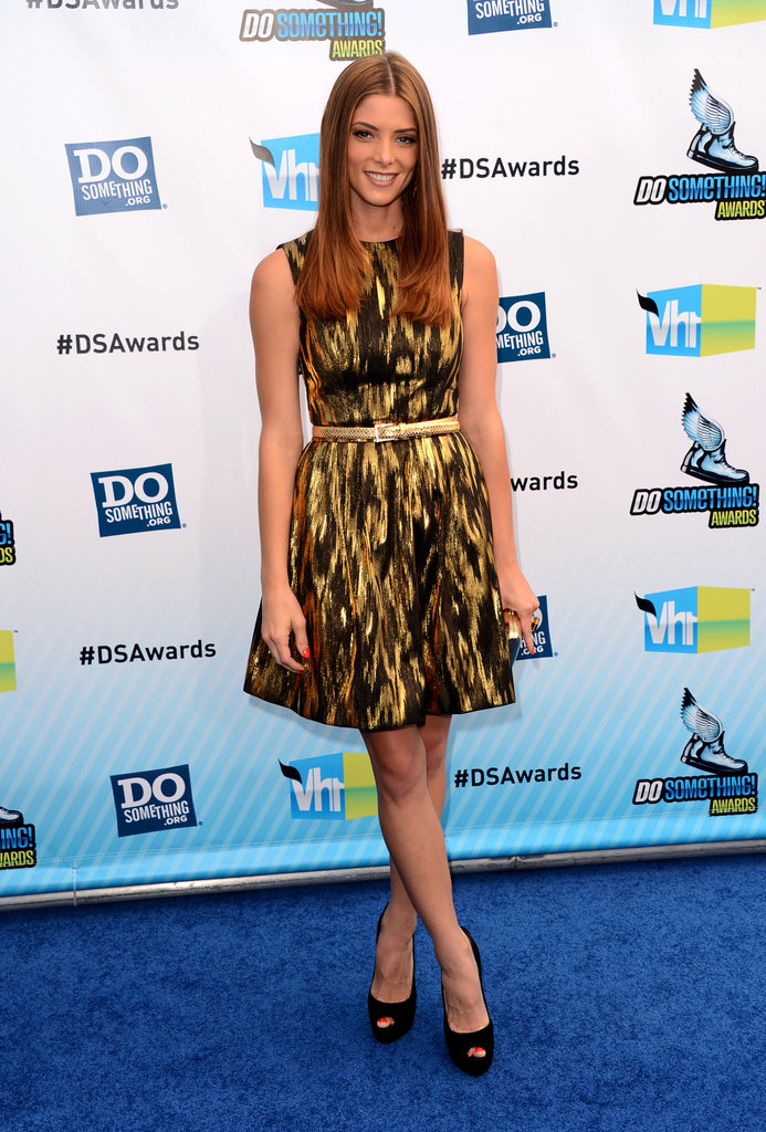 Ashley Greene offered up a double dose of metallic shine via her patterned Michael Kors Resort 2013 dress and matching gold snakeskin belt. Her Roger Vivier clutch and black Giuseppe Zanotti peep-toe pumps polished off the outfit.