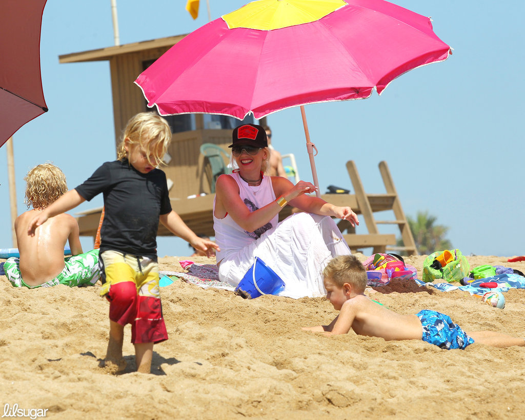 Gwen Stefani hit the beach under an umbrella while son Zuma ran around in the sand at Newport Beach.