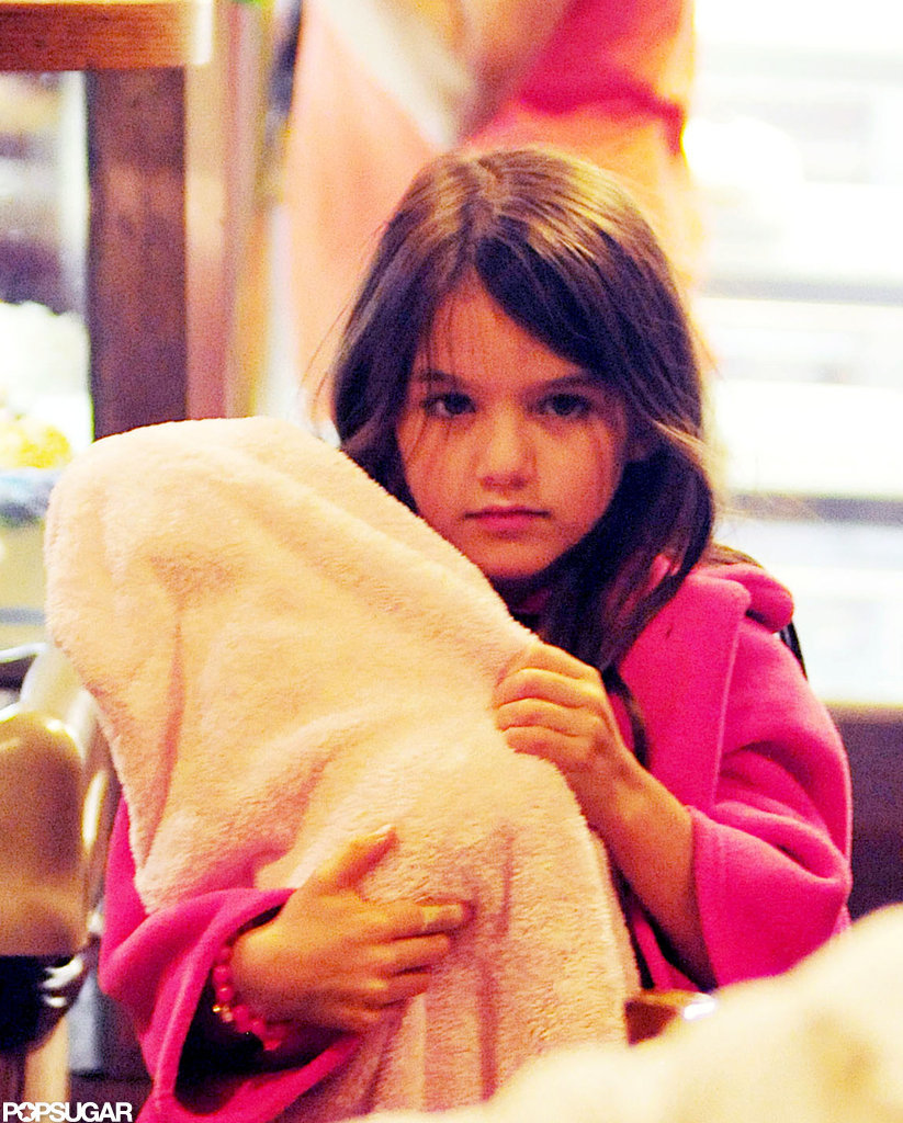 Suri Cruise held her doll in a pink blanket.