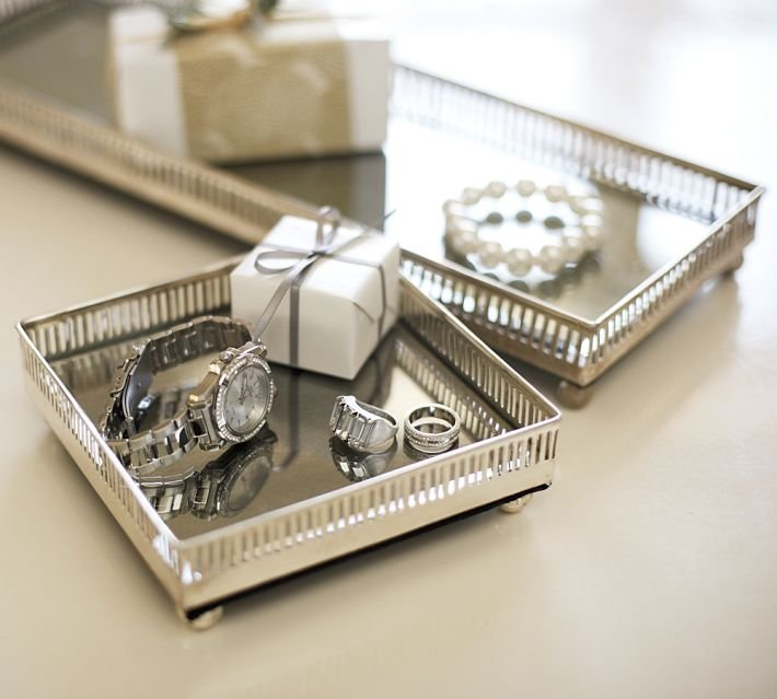 Add elegance and antique glamour to your room with a  Mirrored Dresser-Top Tray ($29). They are a polished way to display keepsakes and hold your jewelry. You can also layer a variety of trays in different sizes by nesting a smaller tray inside a larger tray for more versatility.