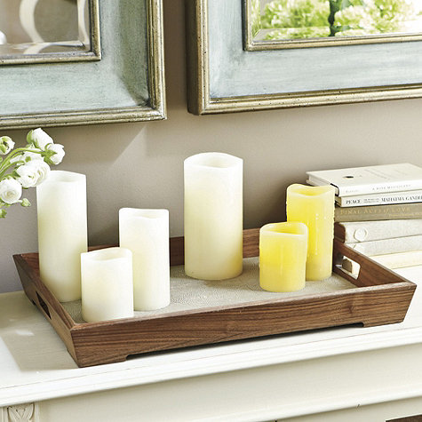 A large tray like this Peyton Tray ($119) can have several different uses, but we love the idea of using it as a surface for candles in different colors and sizes.