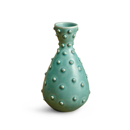 Inspired by barnacles, pebbles, and natural textures, this clay vase toes the line between vintage and contemporary — it looks as though it could be found at either an international flea market or an upscale design boutique. Jonathan Adler Agave Vase ($48)