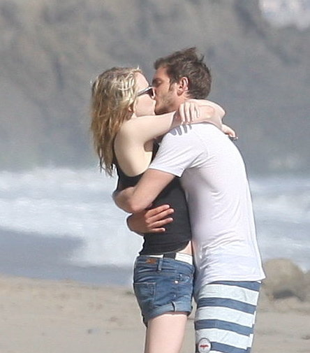 Emma Stone wrapped her arms around Andrew Garfield as he kissed her on the beach.