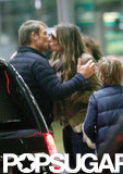 Elizabeth Hurley and boyfriend Shane Warne said goodbye with a kiss during her August departure from Melbourne.