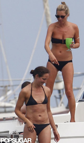 Kate Moss hung out with friends on a boat wearing a black bikini.