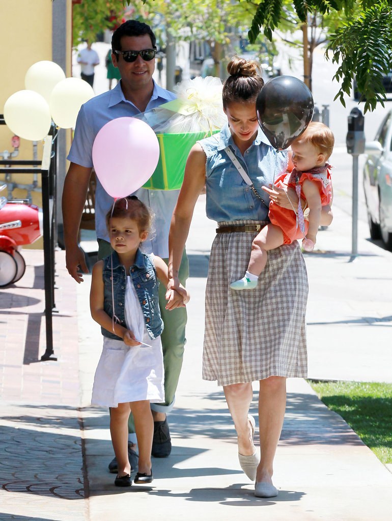 In June, Jessica Alba and husband Cash Warren took daughters Haven and Honor to a birthday party, where Honor sported a denim vest, white sundress, and black flats.