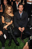 Bradley Cooper and Jennifer Lopez were seated next to each other at Tommy Hilfiger's show in September 2010.