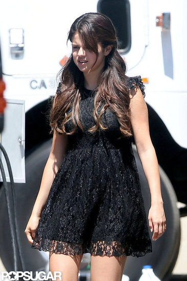 Selena Gomez wore a black lace dress on the set of Feed the Dog.