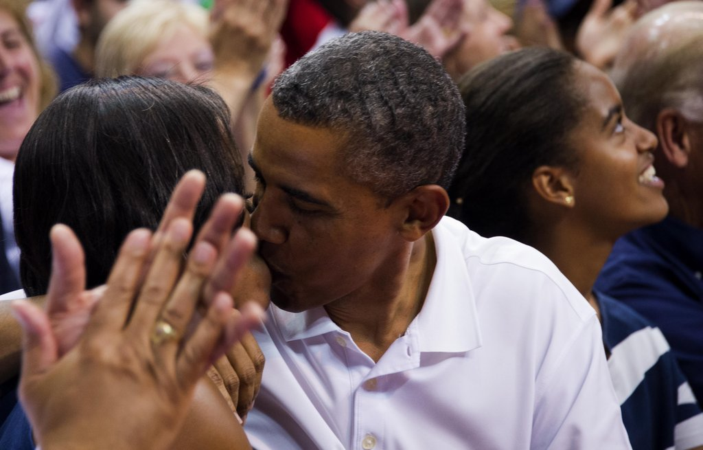 The Obamas smooched at an Olympic basketball game in Washington DC.
