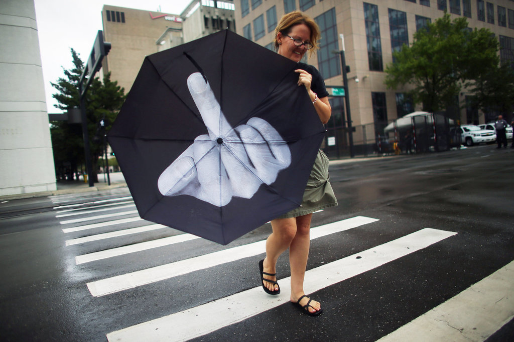 A woman used her umbrella to make a statement ahead of the convention.