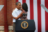 The Obamas embraced at a campaign rally in Dubuque, IA.