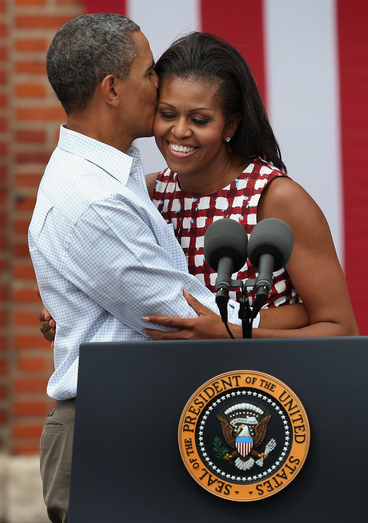Barack Obama gave wife Michelle a big smooch on the cheek at a campaign rally in Dubuque, IA.