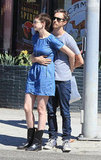 Anne Hathaway wrapped her arms around Adam Shulman in LA.