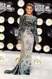 Miley Cyrus arrived in a long gown for the 2011 awards.