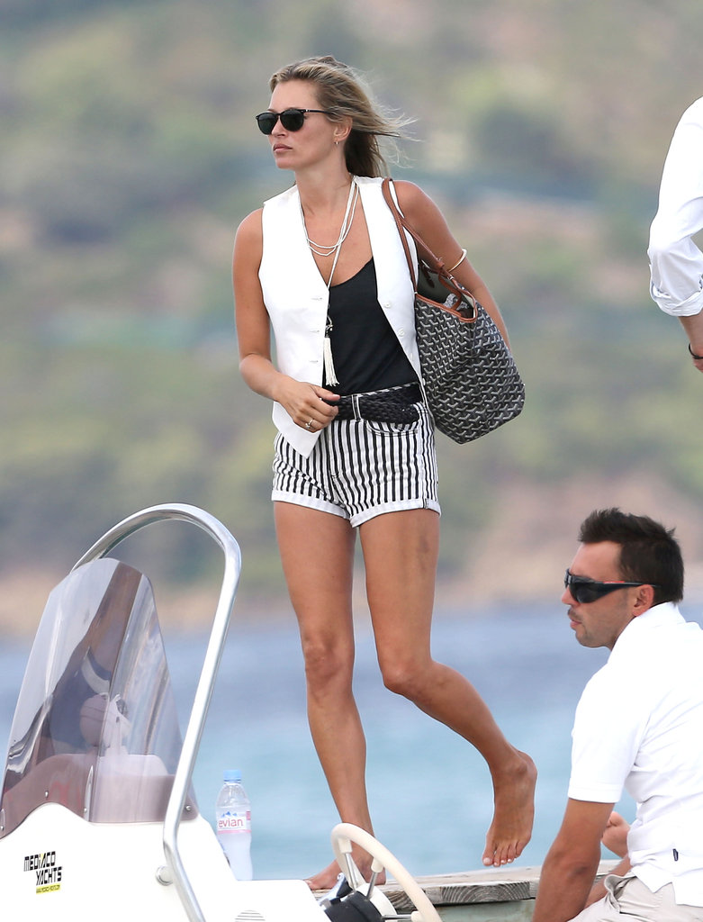 Kate Moss sported a white vest over striped shorts.