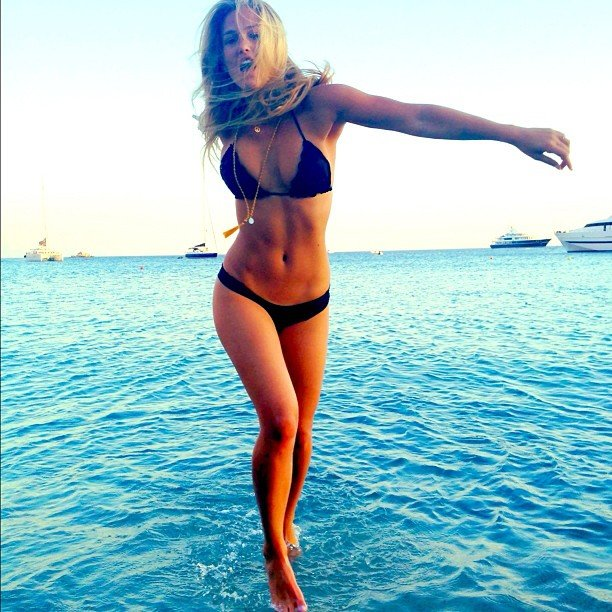 Bar Refaeli appeared to be walking on water during a bikini-filled day at the shore in August. Source: Instagram user barrefaeli