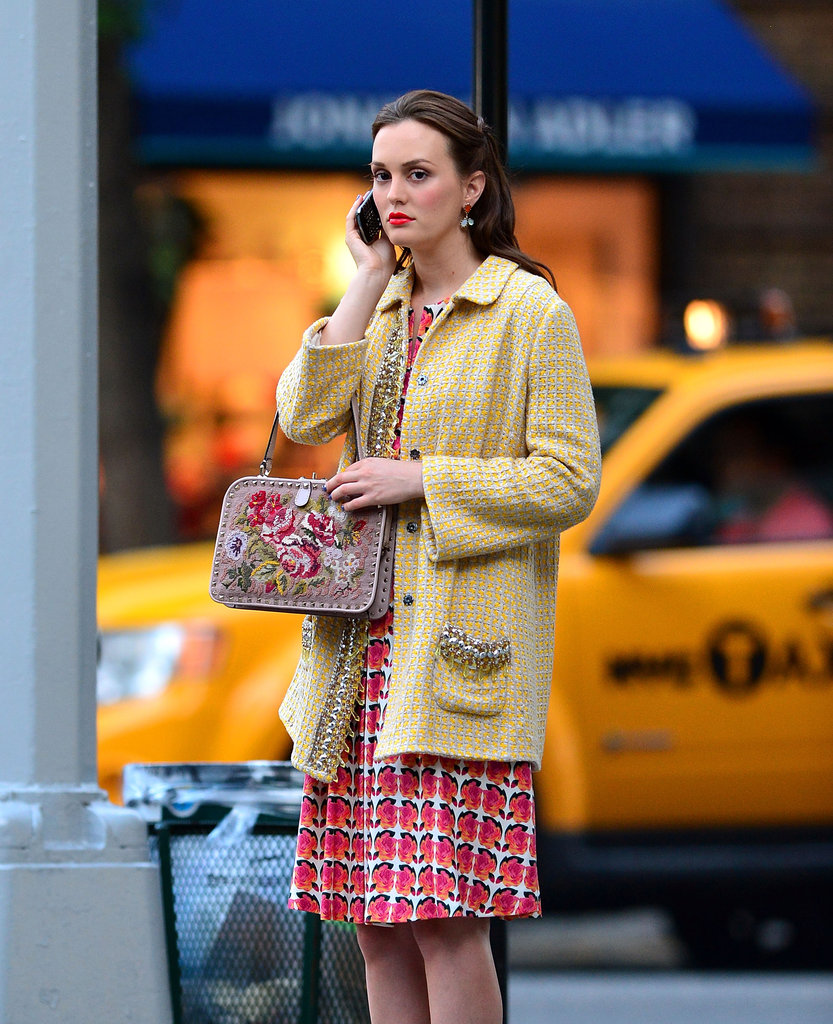 From the tweedy overcoat to her brightly-printed dress, we're loving the overarching theme of mod ladylike wares.