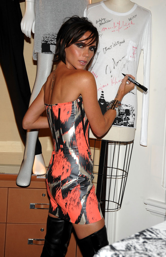 Victoria Beckham signed a t-shirt for fans during a Bergdorf Goodman event in 2009.
