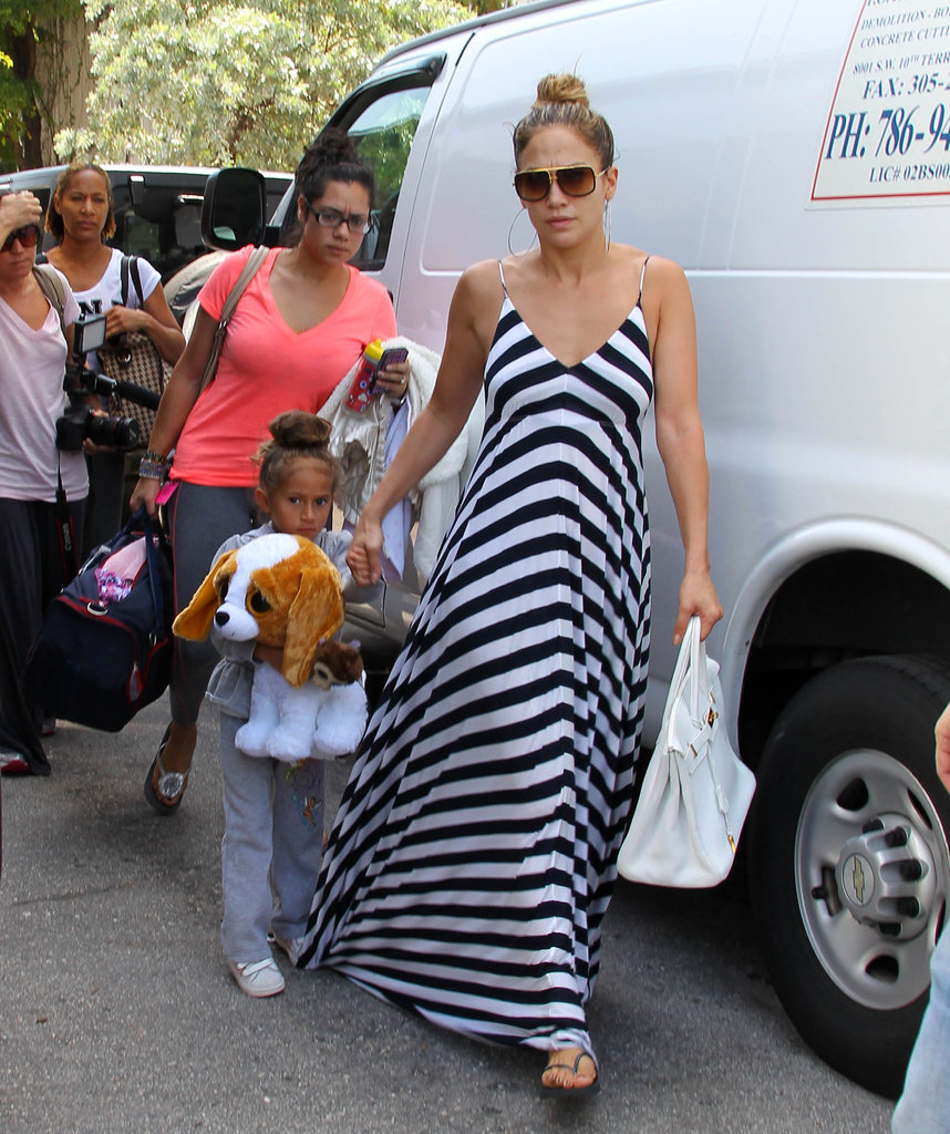 J Lo arrived at her hotel with twins Emme and Max Anthony.