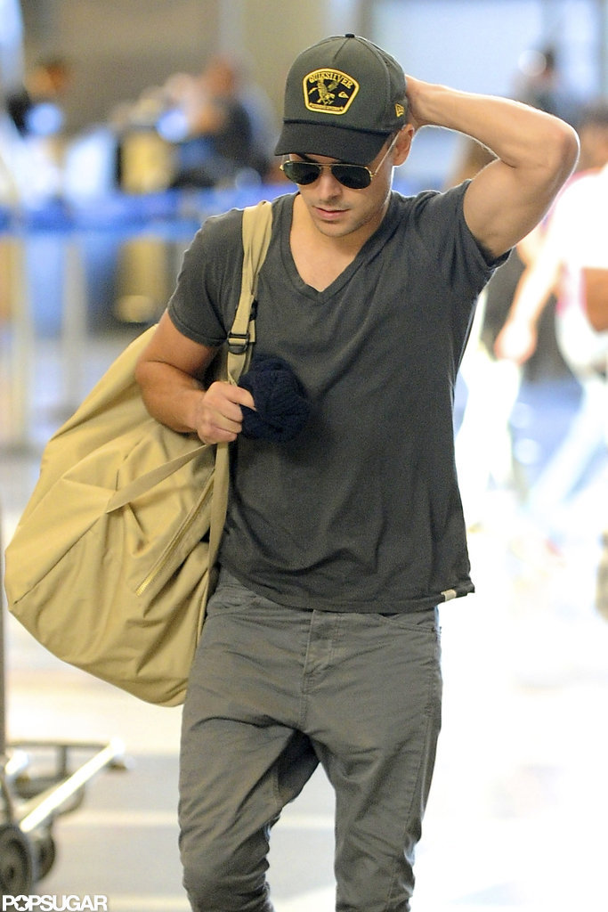 Zac Efron sported a pair of aviator sunglasses at LAX Airport.