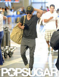 Zac Efron departed from LAX Airport wearing Military like attire.