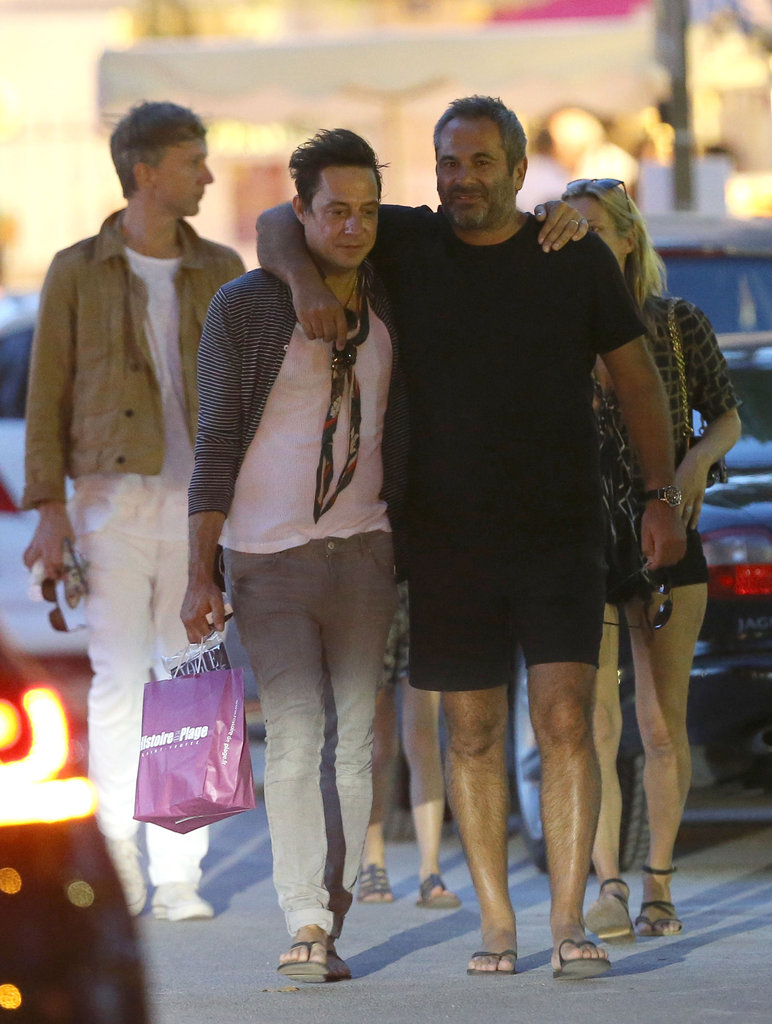 Jamie Hince had his arm around a friend while Kate Moss followed behind.