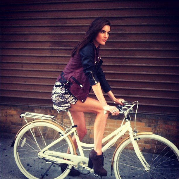 Hilary Rhoda hopped on a bike for a photo shoot. Source: Twitter user HilaryHRhoda