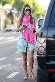 Alessandra Ambrosio went boho and bright in a breezy shirtdress and a fuchsia scarf.