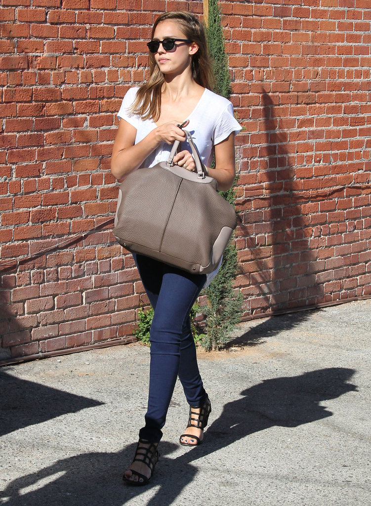 Jessica Alba was low-key cool in a pair of dark skinnies and cage sandals.