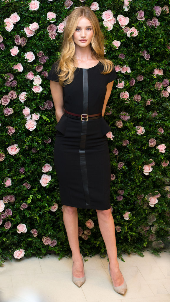 The gorgeous Rosie Huntington-Whiteley opted for a classic-with-a-twist peplum and leather-trimmed Marks & Spencer LBD and cap-toe pumps at an event in London.