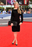 Decidedly different from her white floral Gucci look, Brit Marling stepped out earlier in a long-sleeved LBD, toting an oversize embossed black clutch.