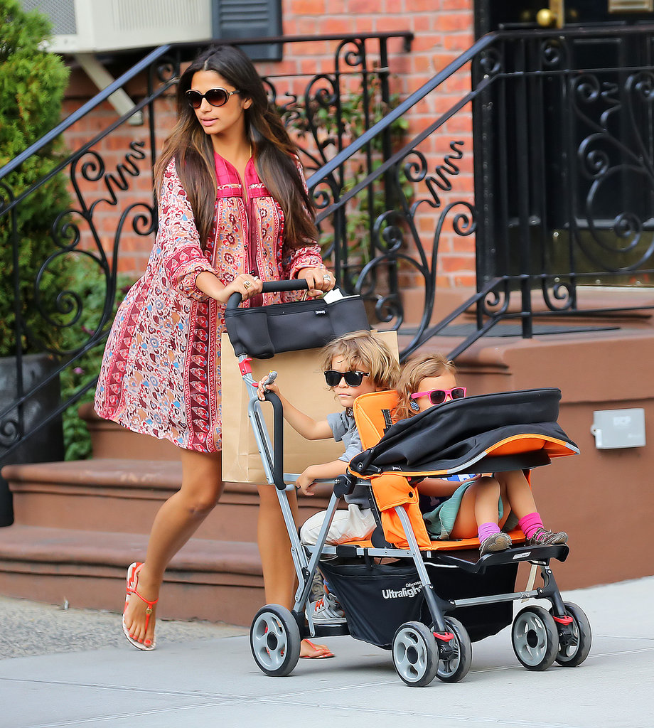 Pregnant model Camila Alves McConaughey kept things relaxed and chic as she strolled around New York City. Her loose-fitting, flowing dress is perfect for a growing belly, and looks great paired with those neon sandals. It's a look that could take you from a day at the beach, to a glamorous lunch, and Camila nails it.
