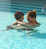 Jennifer Lopez wrapped her arms around beau Casper Smart in the pool.