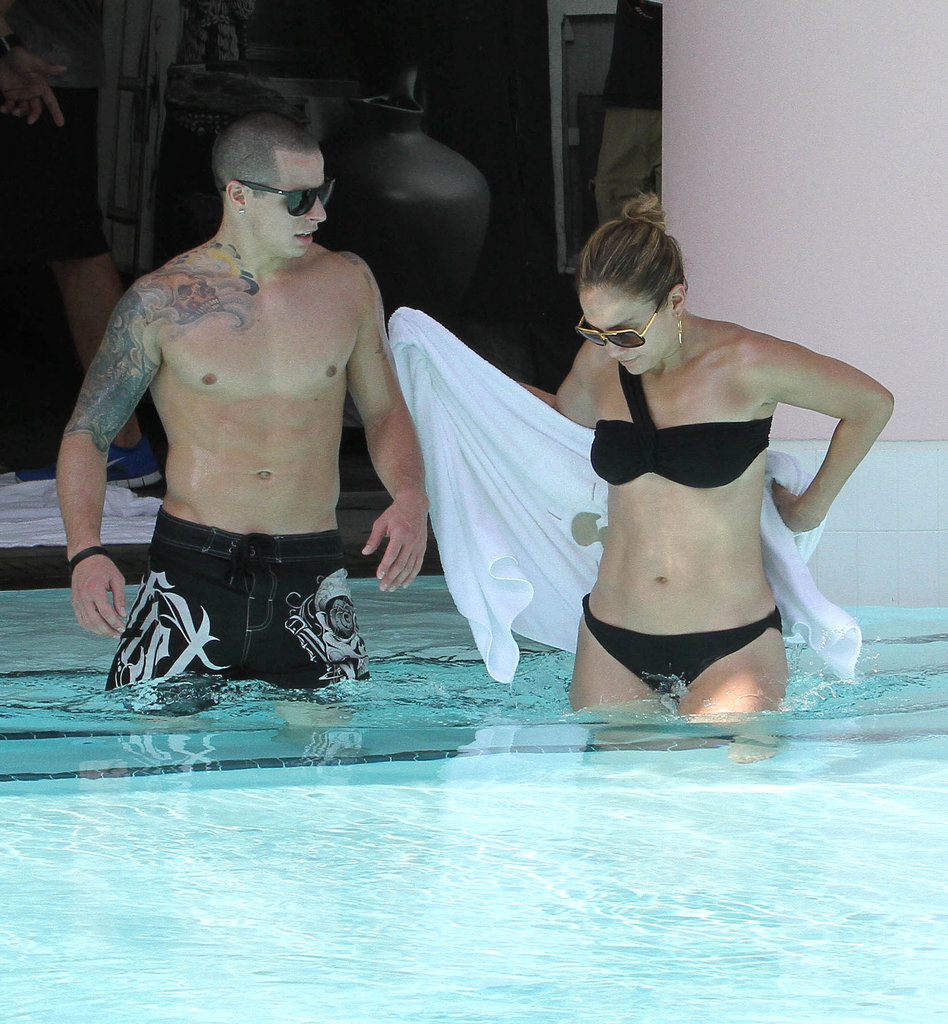 Jennifer Lopez showed off her abs in a black bikini with Casper Smart.