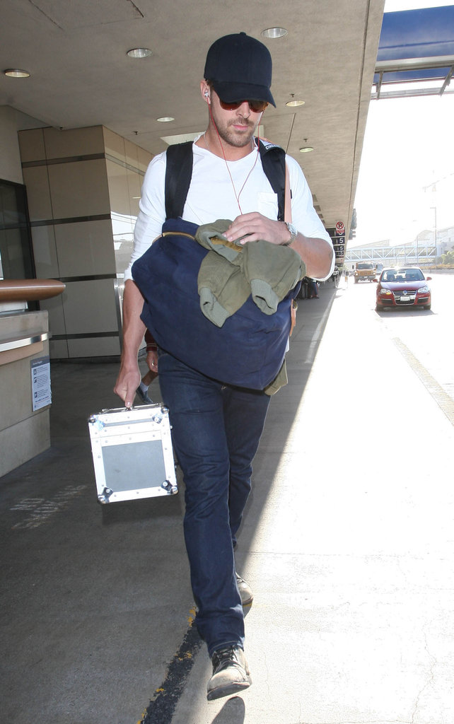 Ryan Gosling left the airport in LA.