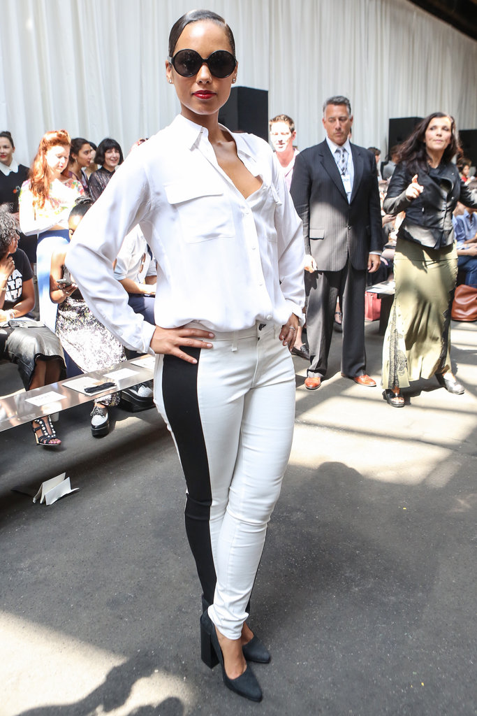Alicia Keys punched up an all-white outfit at Edun with a bold black racing-stripe-style jean.