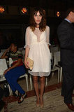 Alexa Chung looked sweet in a sheer-paneled ivory shift and nude ankle-strap flats at the Elle Fashion Next show.