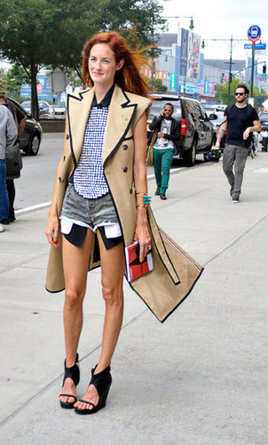 Taylor Tomasi Hill worked a bold trench, printed top, and a cutout booties with ease outside the Prabal Gurung show.