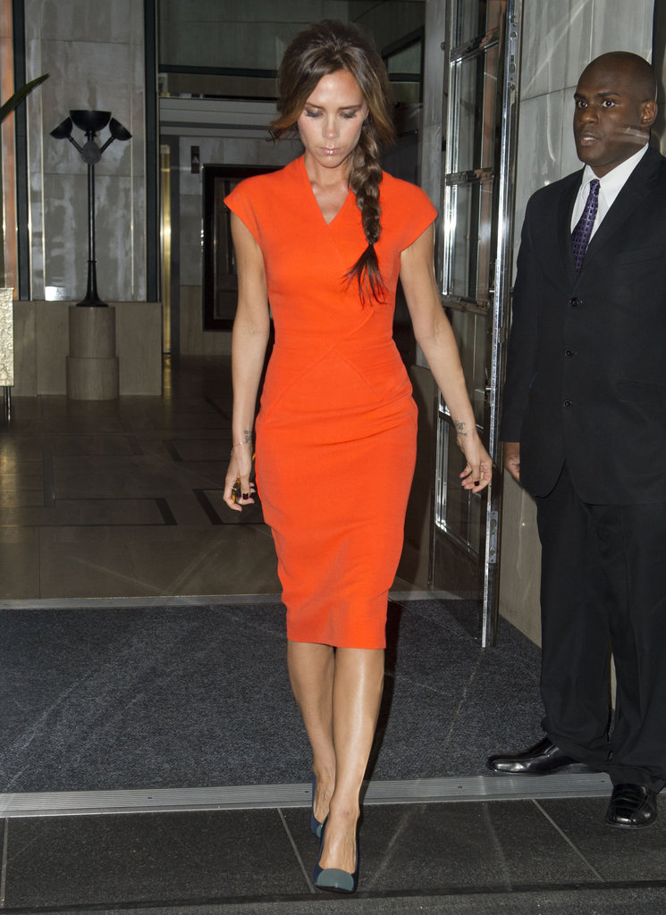 Nobody can work a Victoria Beckham dress like the lady herself! We love the punchy orange colour and flattering cut of the dress. She knows what she's doing, that's for sure!