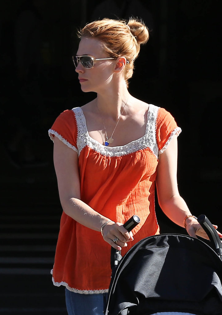 January Jones wore her hair in a high bun.