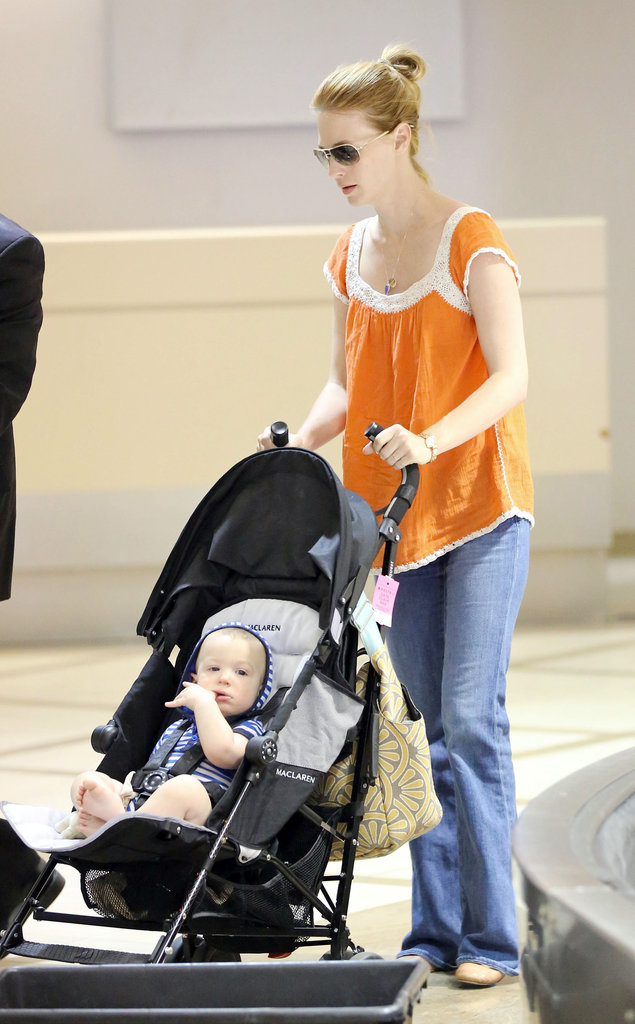 January Jones pushed Xander Jones's stroller through LAX.
