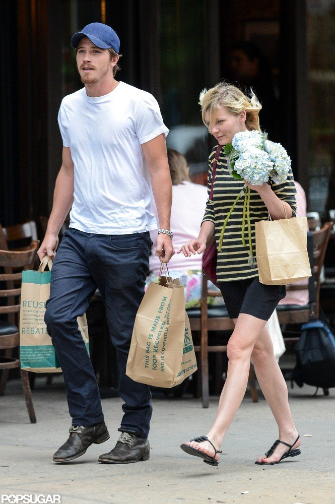 Kirsten Dunst and Garrett Hedlund walked out of Whole Foods with grocery bags.