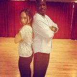 Cheryl Burke stood back to back with her DWTS partner, Emmitt Smith. Source: Instagram user cherylburke