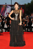 Olga Kurylenko indulges in leather and lace via a sexy black Valentino gown at the premiere of the film To the Wonder.