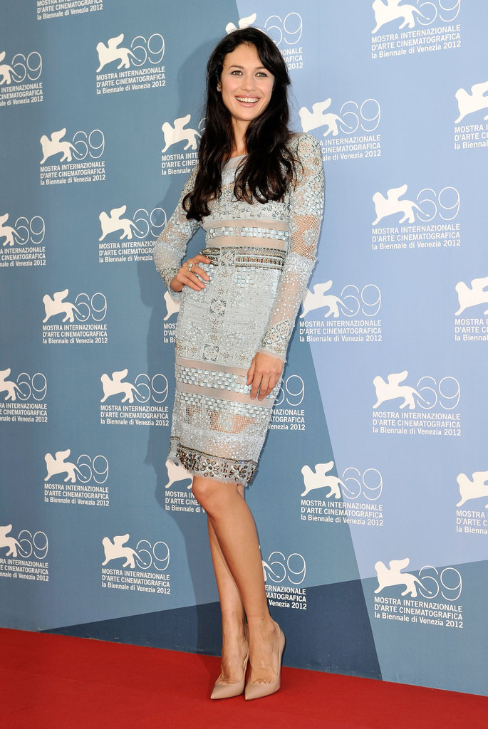 Olga Kurylenko first stepped out in a lacy powder blue Emilio Pucci dress and Christian Louboutin pumps for her film's photocall.