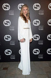 Brit Marley channeled a serious '70s-inspired moment in this white one-of-a-kind Gucci gown. The embellished belt at the waist cinched the loose form for a perfect touch of glitz.